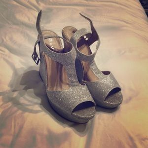 Open toed silver sparkly wedged heels